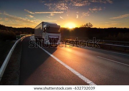 Truck transportation at sunset #632732039