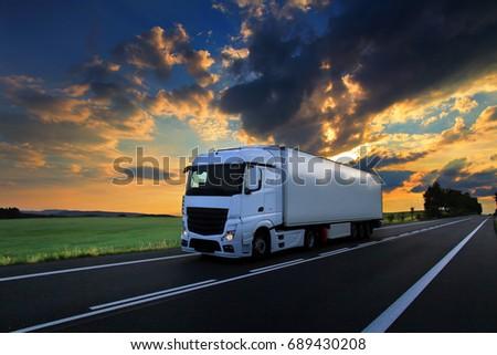 Truck transportation at sunset #689430208