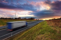 Truck transportation on the road at sunset