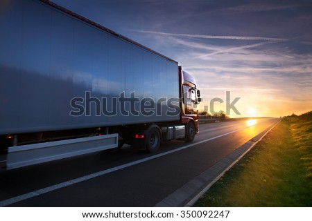 Truck transportation on the road at sunset #350092247