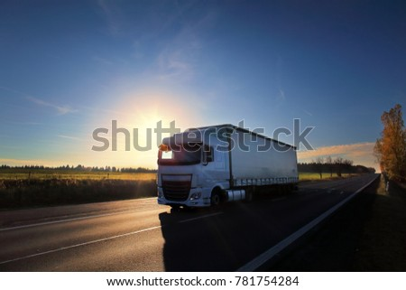 Truck transportation on the road at sunset #781754284