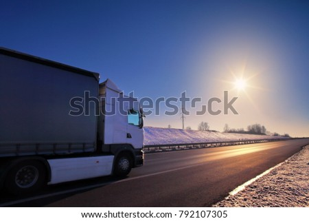 Truck transportation on the road at sunset #792107305