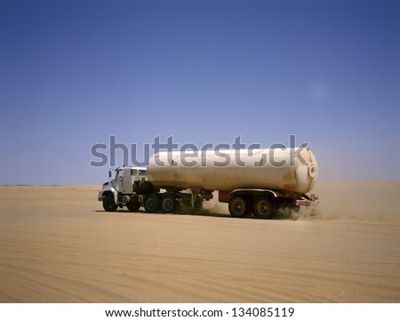 Truck transporting oil in the Arab desert