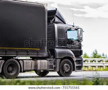 truck transports freight on the country highway #755755561