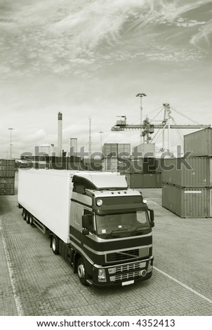 truck waiting for cargo in a busy commercial-dock, port and in a duplex metal toning idea