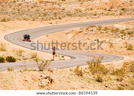 Truck with a boat trailer on a winding desert road