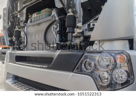 Truck with an open motor compartment. Transport