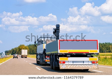 Truck with Car trailer on the roadway in Poland.