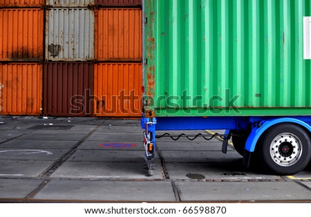 Truck with container in a terminal
