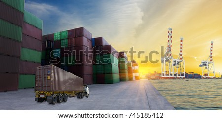 truck with container in yard port working transport big tank to big crane for import export goods . #745185412