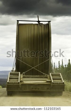 Truck with oversize load on the gravel road of Alaska