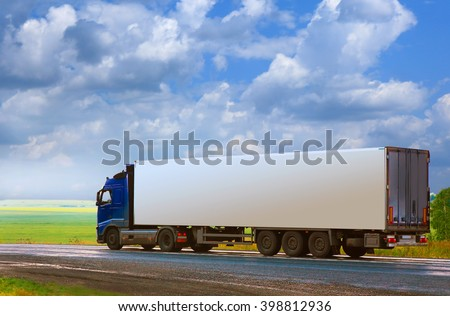 truck with the container goes on the country highway #398812936