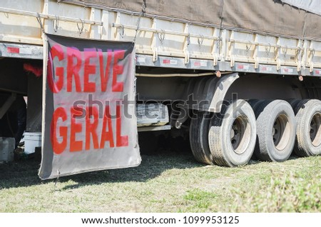 Trucker on strike. Side of a truck with a message written