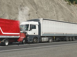 Trucks accident. Road accident. Two trucks collided head-on.