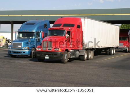 Trucks at a truckstop fueling station