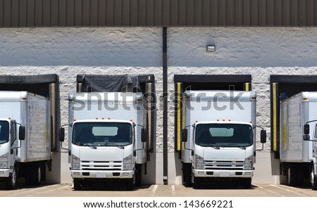 trucks at loading dock shipping industry