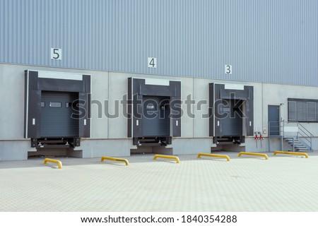 trucks at loading ramps of a warehouse Stockfoto ©