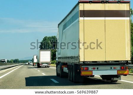 Trucks at the road in Switzerland #569639887