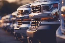 Trucks Dealer Vehicles Stock Row. Selective Focus. Automotive Dealership.