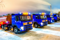 trucks for dangerous materials at night with flashing beacons