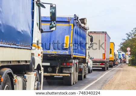 trucks in traffic jam on the road during the day