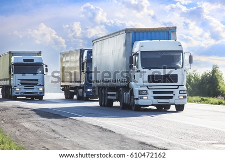 trucks moves on the country highway #610472162