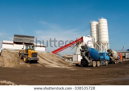 Trucks waiting to fill the concrete factory.