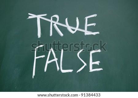 true and false title written with chalk on blackboard