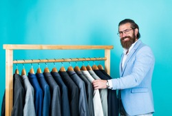 true gentleman with groomed hair. male beauty and fashion. showroom concept. bearded man in formalwear. elegant businessman choose apparel for formal event. atelier or wardrobe. Feel the divine.