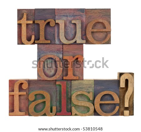 True or false question in vintage letterpress type blocks stained by color inks , isolated on white