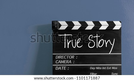 true story title on wooden clapper board
