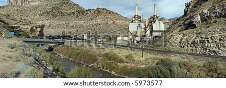 True wide panorama of an electric power plant in a Utah canyon