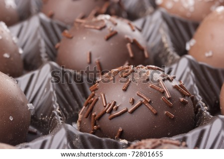 Truffle candy coated chocolate with decorative powdered for the occasion.