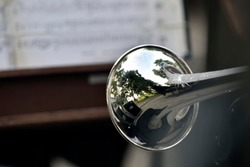trumpet against the background of sheet music during an open-air concert