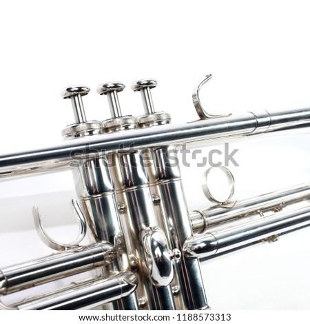Trumpet music brass instrument. Wind  instrument closeup. Trumpet isolated on white #1188573313