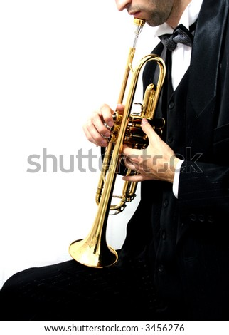 trumpet music player in a luxury suit and his golden trumpet