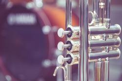 Trumpet on drum background