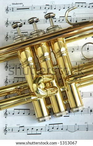 Trumpet on musical notes as background