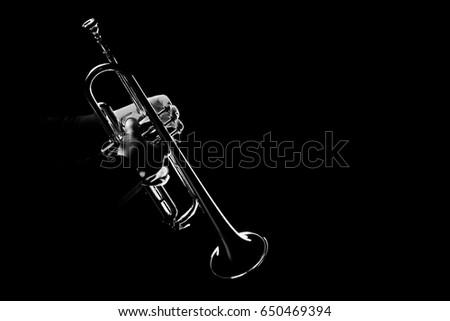 Trumpet player jazz instrument. Trumpeter playing horn music instrument.