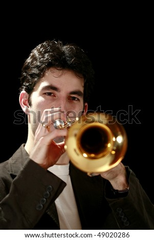 trumpet player on a black background and his golden trumpet