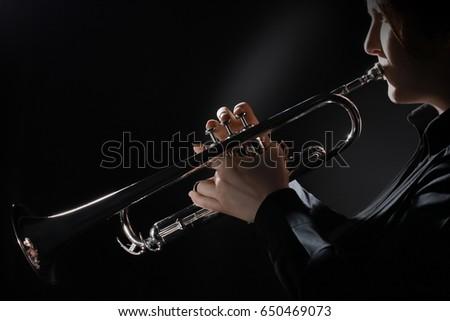 Trumpet player playing jazz music instrument. Trumpeter jazz player #650469073