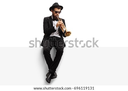 Trumpet player sitting on a panel isolated on white background