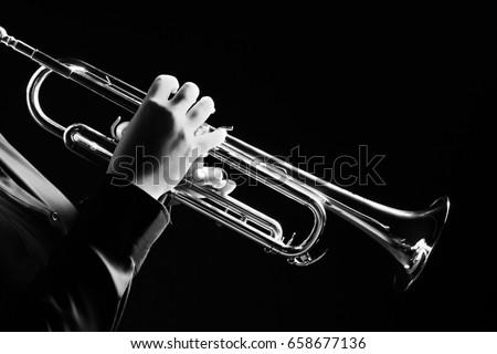 Trumpet player. Trumpeter playing music jazz instrument. Brass orchestra instrument.