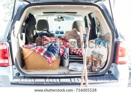 Trunk of SUV packed for a weekend road trip