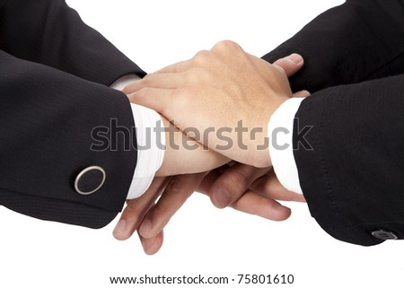 Trust and cooperation  concept. stacked hands of businessman - stock photo