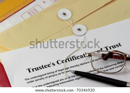 Trust certificate with pen and manila envelop