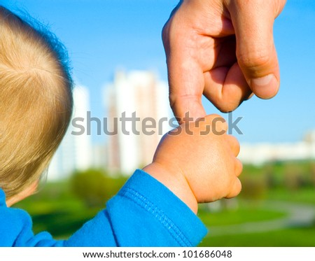 trust family hands of child son and father on wheat field nature outdoor