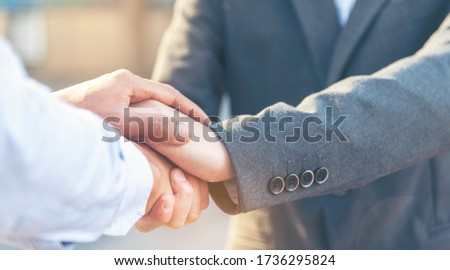 Trust Promise Concept. Honest Lawyer Partner with Professional Team make Law Business Agreement after Complete Deal. Ethics Business people handshake, touch and Respect customer to trust partnership. Foto stock ©