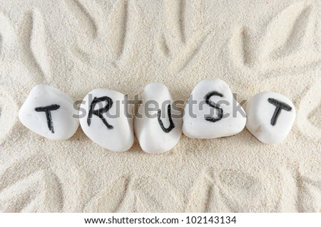 Trust word on group of stones on the sand