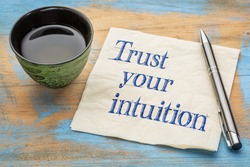 Trust your intuition reminder - handwriting on a napkin with a cup of tea